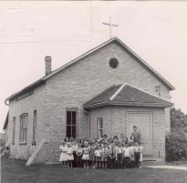 Black and white photograph of school children and teachers outside of St. Theresa's School Burford, [196?], (DHA.001.162)
