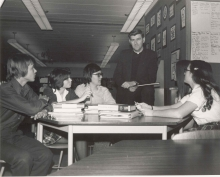 Photograph of Father Ron Cote with Bishop Ryan High School Students. Fr. Cote was principal of Bishop Ryan High School from 1962 to 1975, [197-], (DHA.001.516)