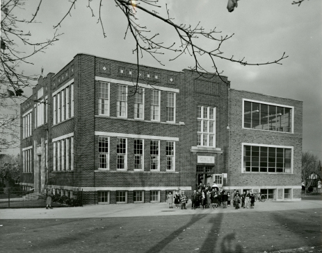 Black and white photograph of school children outside of St. John the Baptist Catholic Elementary School in Hamilton, ON, 1955, Photo Credit: Bochsler Studio, (DHA.001.589)