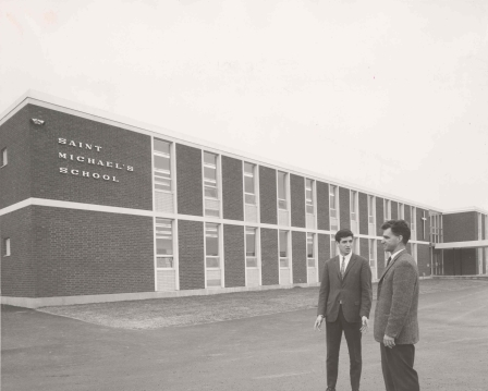 Photograph of the newly built St. Michael's School with First Principal Jim Hanson, at right, 1966, Photo Credit: The Canadian Register, (DHA.001.612)