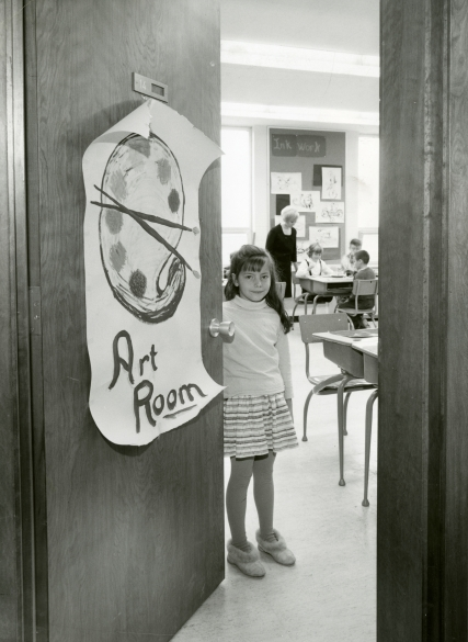 Black and white photograph of a student opening the door to the art room of the newly built St. Michael Catholic Elementary School in Hamilton, ON, 1966, Photo Credit: The Canadian Register, (DHA.001.613)