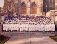 Colour photograph of the first graduation class of Assumption High School, Burlington in regalia on the steps of the Cathedral of Christ the King Hamilton, May 1981, (DHA.001.038)